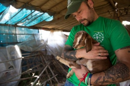 Adam Parascandola with an orphaned baby goat in Kalitaar, a small village outside Kathmandu that was severely damaged by the earthquake. Photograph: Jodi Hilton/Humane Society International